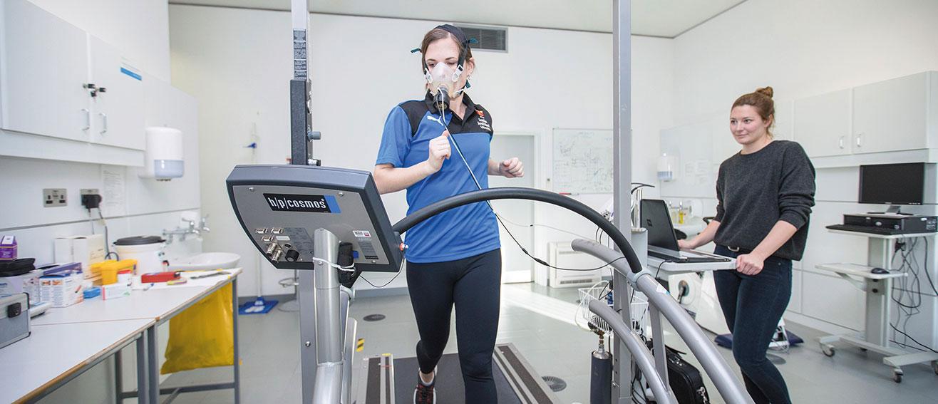 lady runs on treadmill in lab