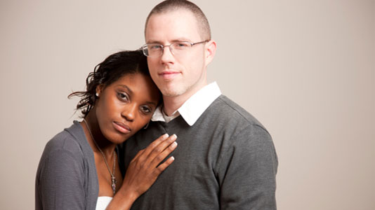 black woman and white man in an embrace