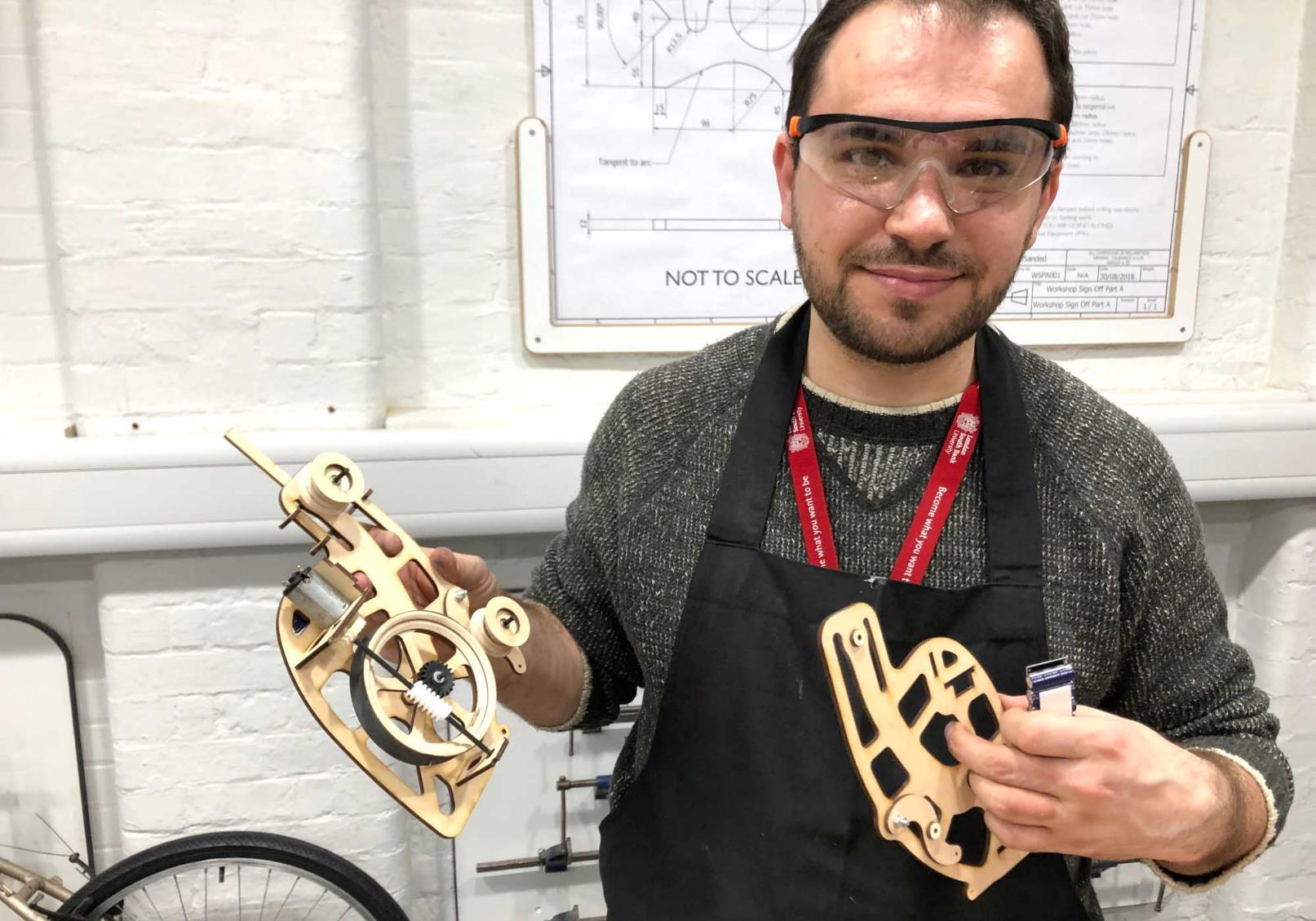 man holds things he made