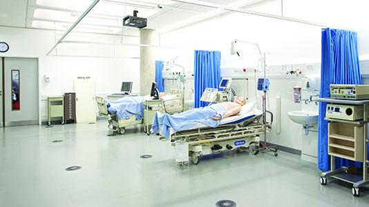 SimMan dummy on a hospital bed in a skills lab