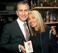 Tom Toumazis celebrating his MBE with wife Helen