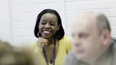 Woman smiling in lecture