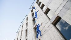 Blue men on building near London Bridge