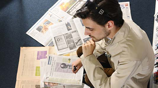 Politics students study newspapers, media, legislation and processes
