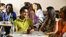 Student socialising in a cafe