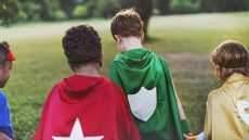 A group of children dressed as superheroes
