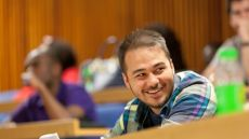 Student smiling in a lecture