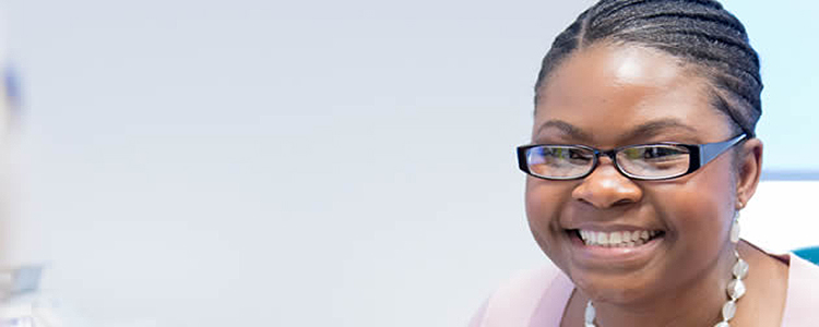 Lady in glasses in office