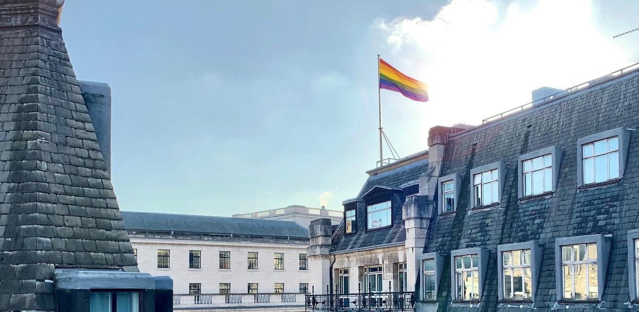 rainbow flag on sunny day on building