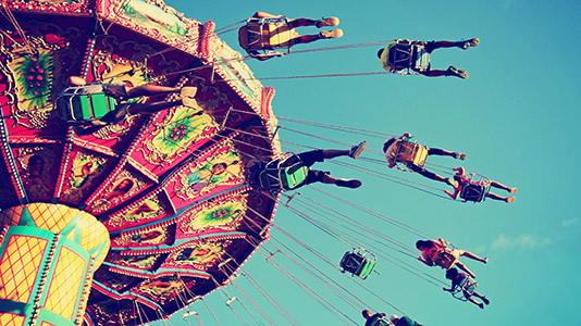 People on a carousel at a fairground