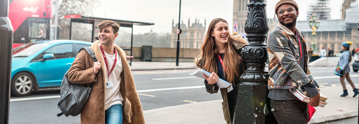 Students smiling on street