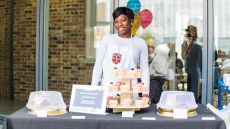 A woman manning her cake business stall